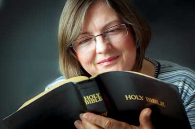 Woman reading Catholic Bible